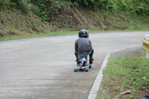 His first longboard competition.  - Here's my son on a down hill longboard competition.