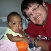 Then - This is Amyra when she was in the hospital way before the adoption was final. They had to take her a couple of times due to pneumonia stemming from her underdeveloped lungs due to being premature.