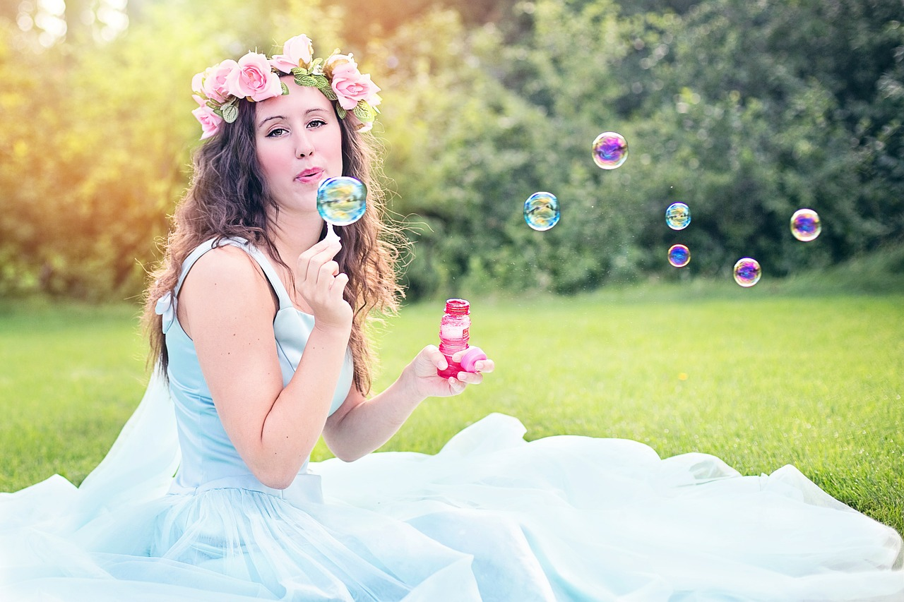 Pixabay Free Images https://pixabay.com/en/woman-blowing-bubbles-young-sitting-609252/