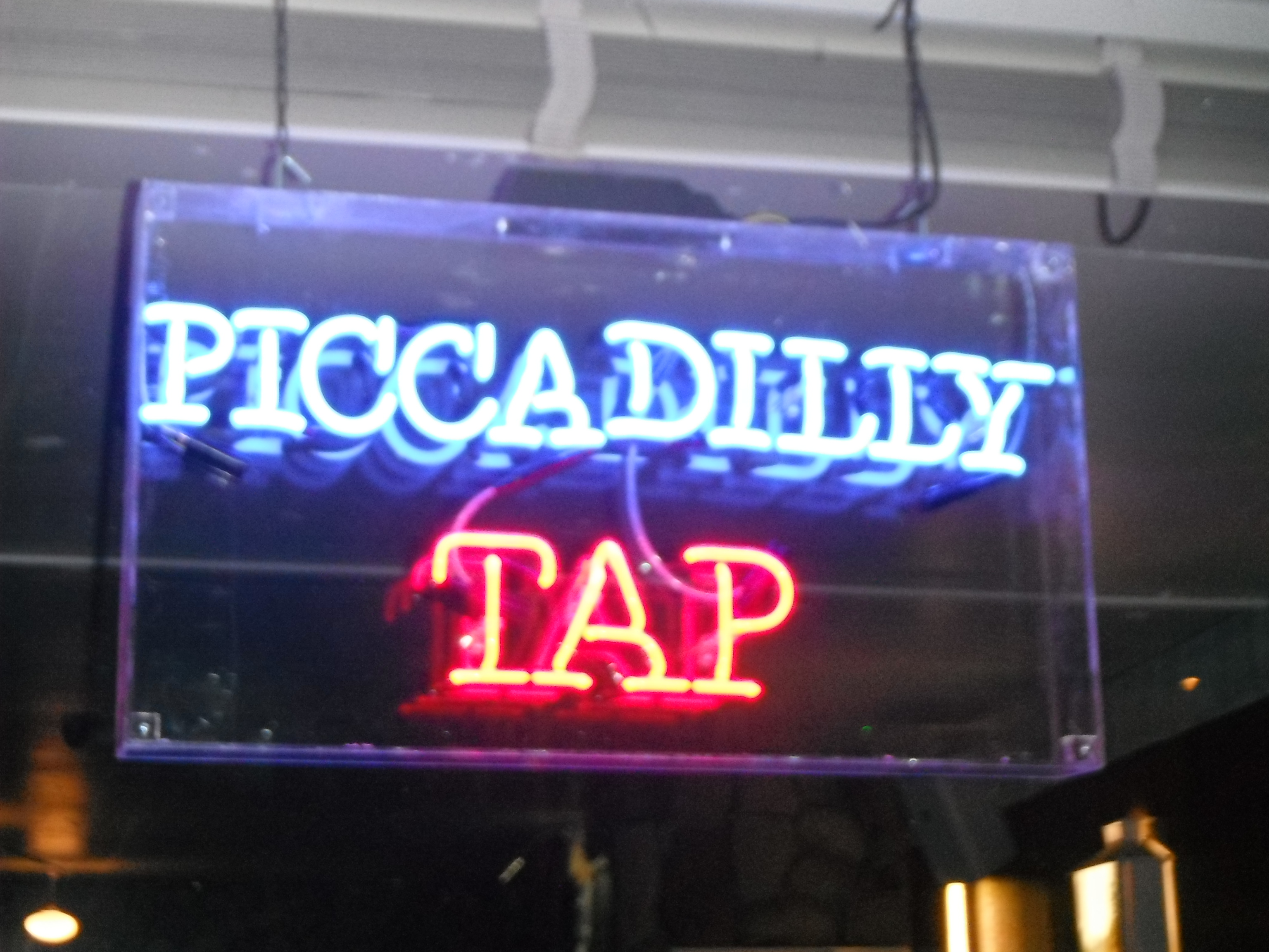 Photo taken by me – the Piccadilly Tap neon pub sign