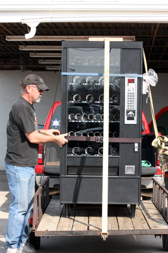 Hubby loading up new snack machine.