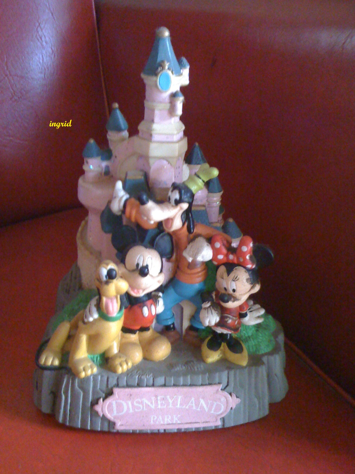a figurine of walt Disney characters from our cabinet