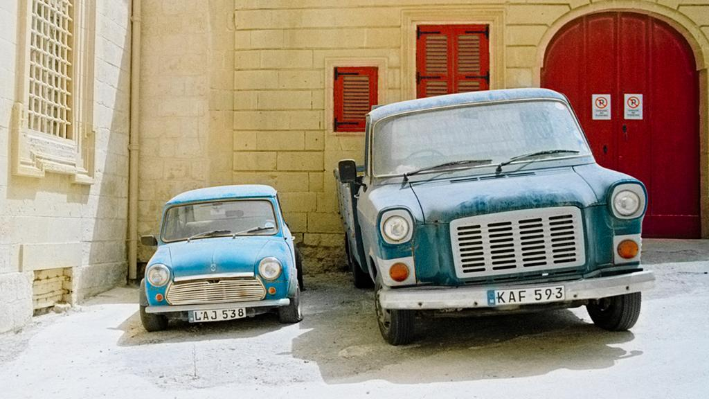 Vehicles parked-up outside a house in Malta
