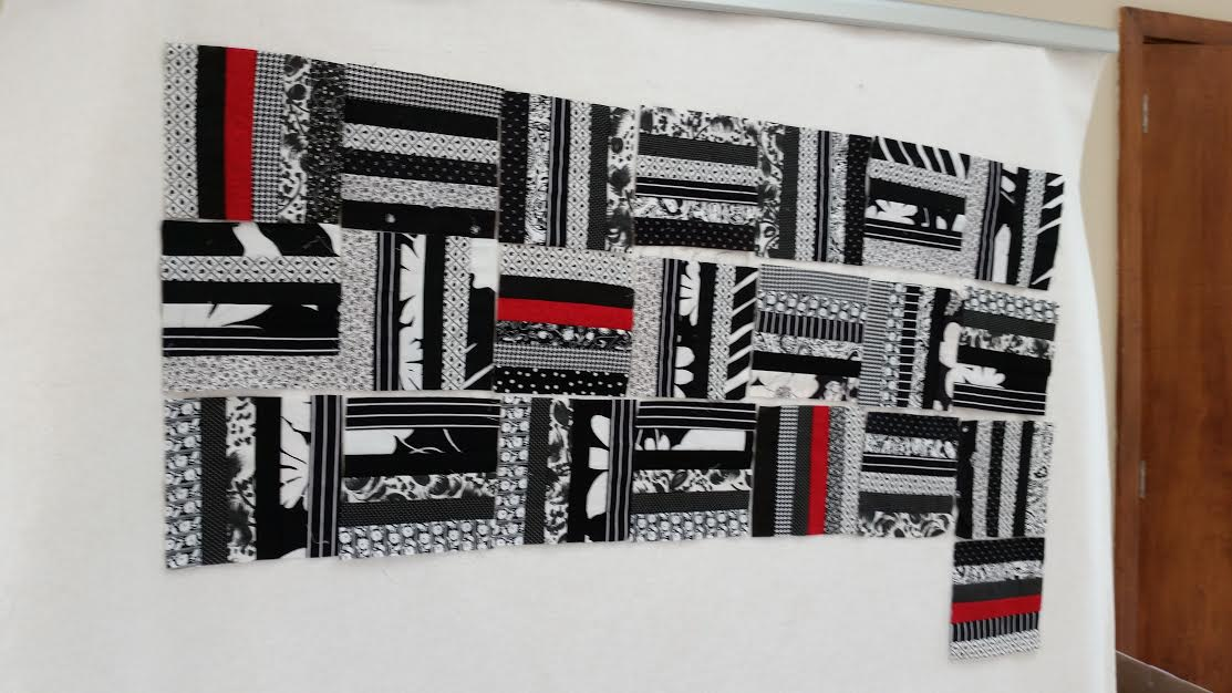 Black and White with a touch of Red quilt top I am working on