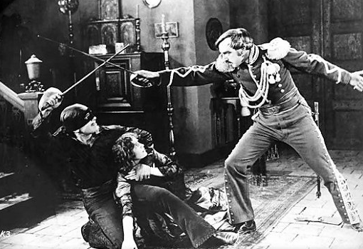 "By Cena do filme ""A Marca do Zorro"" (1920) (www.goldensilents.com/stars/markzorro.jpg) [Public domain], via Wikimedia Commons"