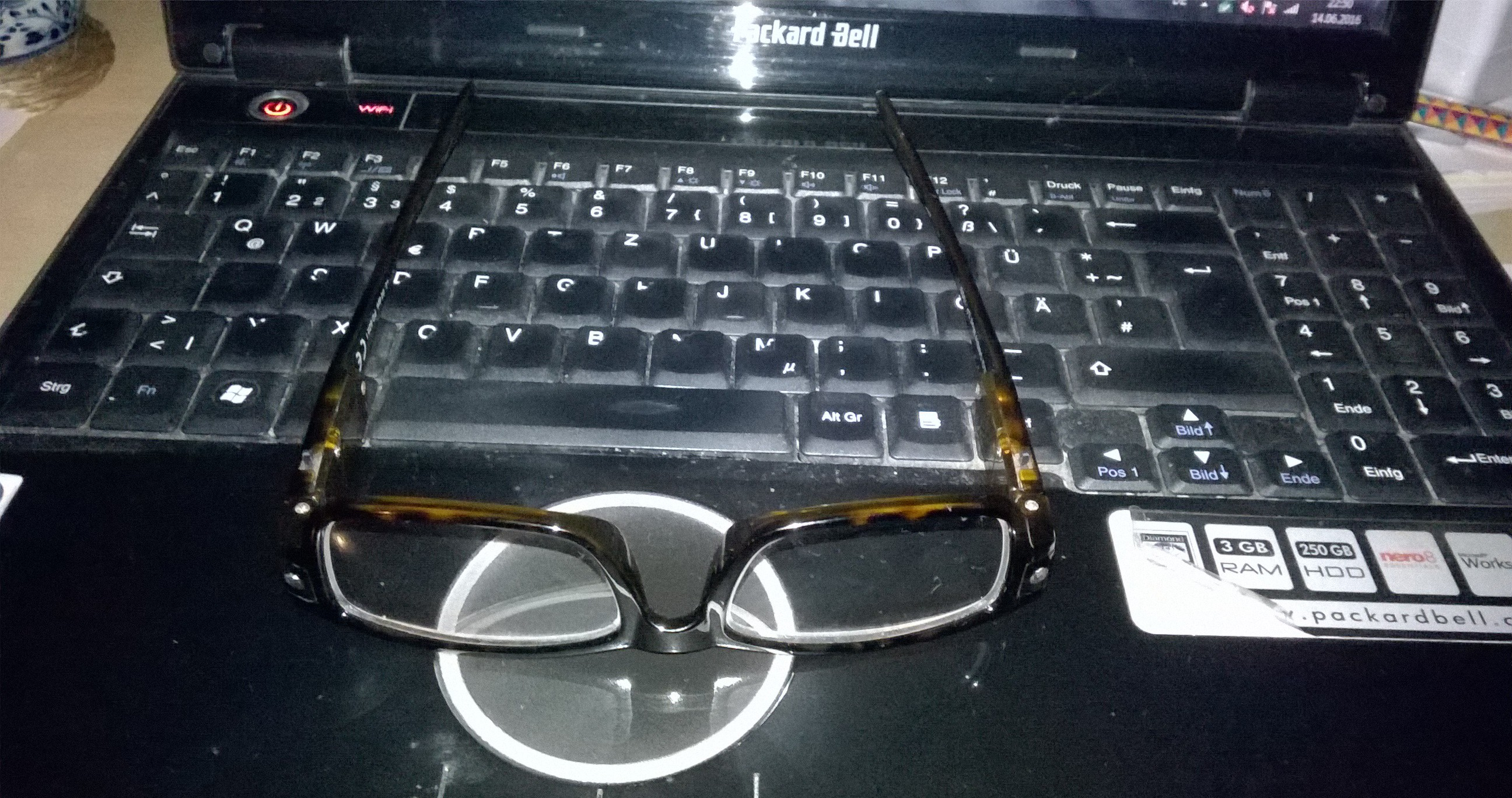 Reading Glasses w/ lights on an old laptop by thelme55
