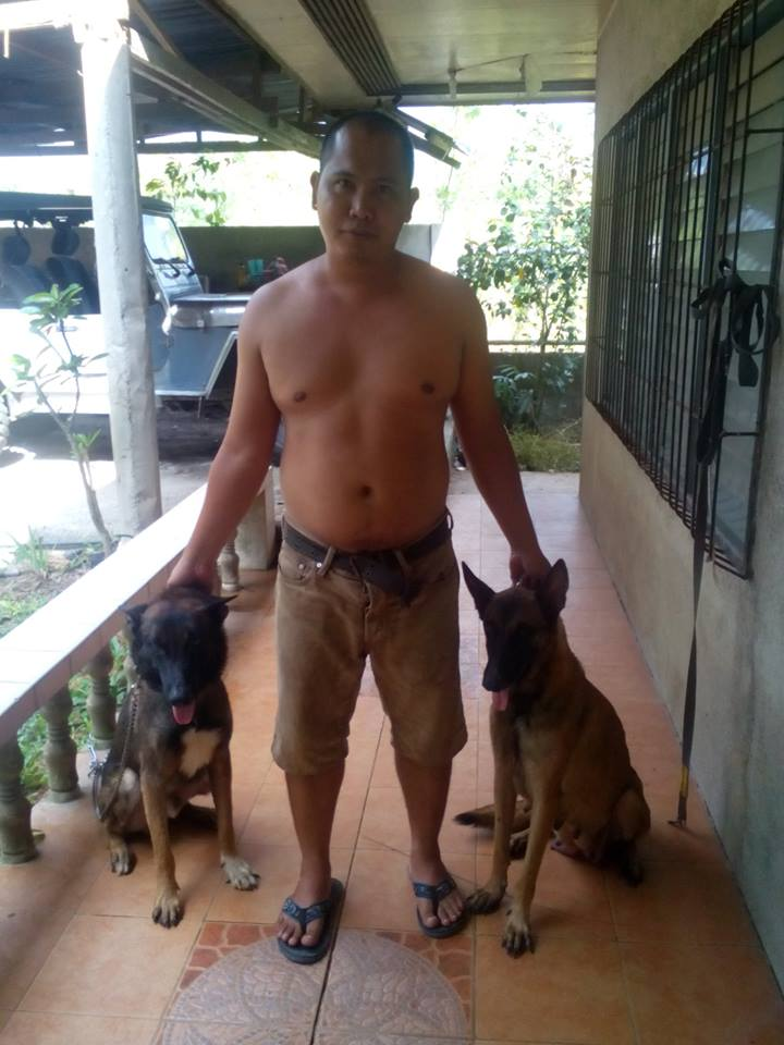 our Belgian Malinois (don't mind my hubby in the middle! lol)