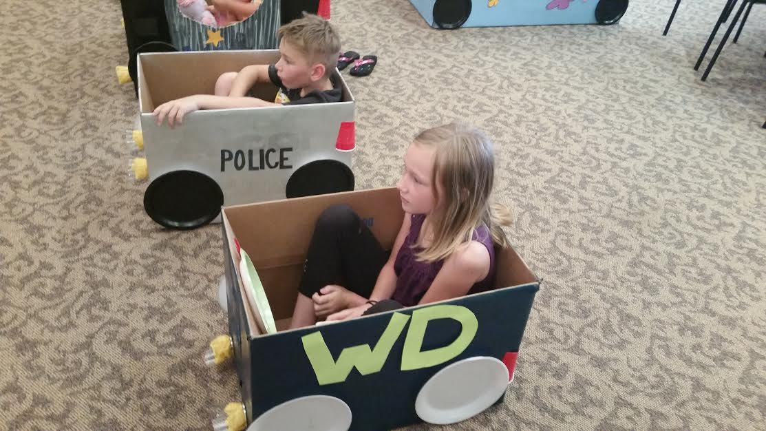 Willo and Jacob in the cars they made for drive in movie night.