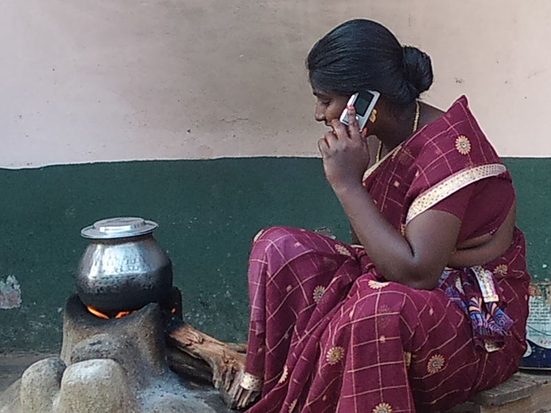 https://commons.wikimedia.org/wiki/File:Tamil_rural_woman_with_a_mobile_phone_facility.jpg