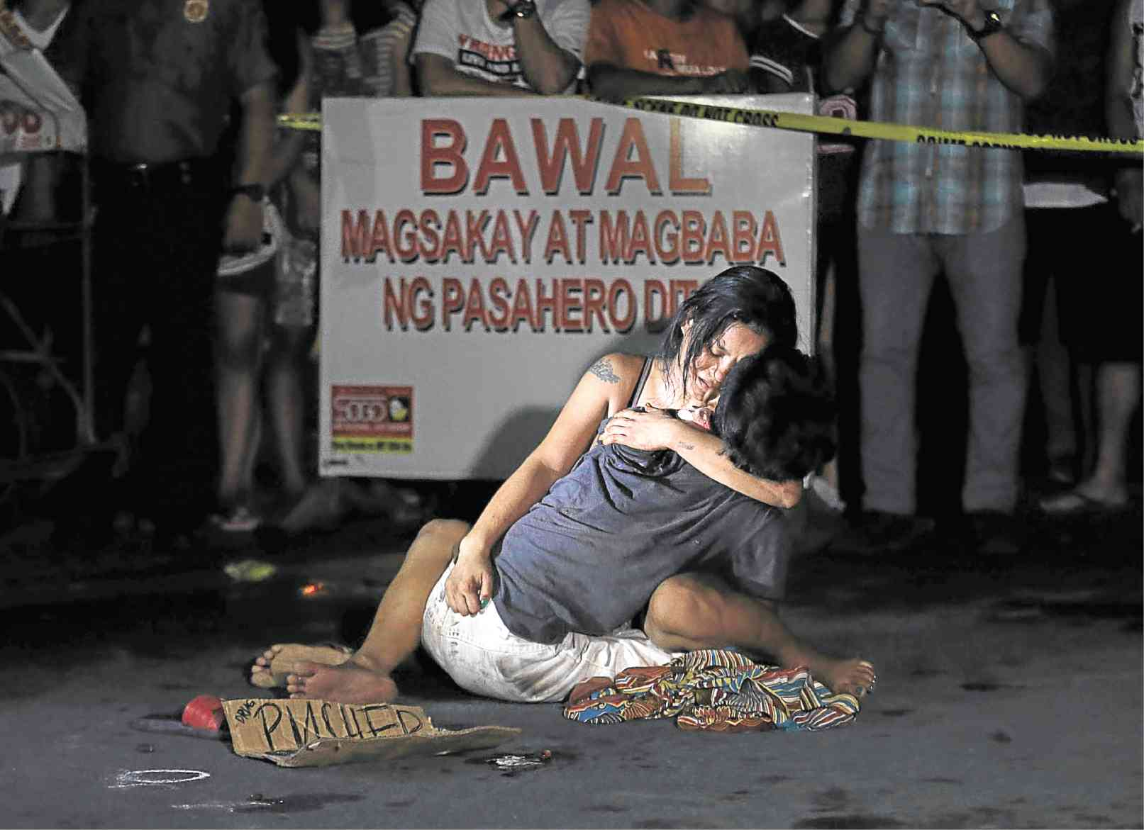 Photography by NOEL CELIS. Visually speaking I am so amazed of this Pieta Style portrait but still have sympathy with this couples because the man was only killed by unidentified gunman then just put the caption that he is a pusher. There is no assurance that he is suspected Drug addict. This crime happened near to our place where I live which is in Pasay City. I saw a comment that they are related to this person and he has no trace of Drugs. Yet he only work hard for his family they are really poorer than rats.