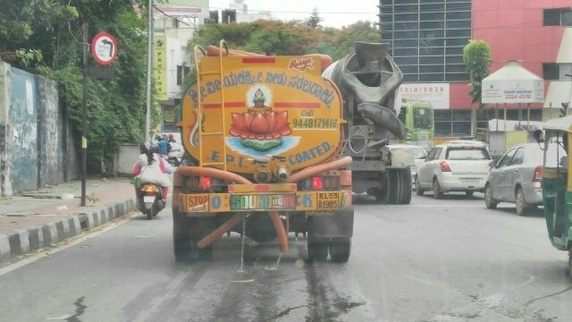 water pouring out from a water tanker