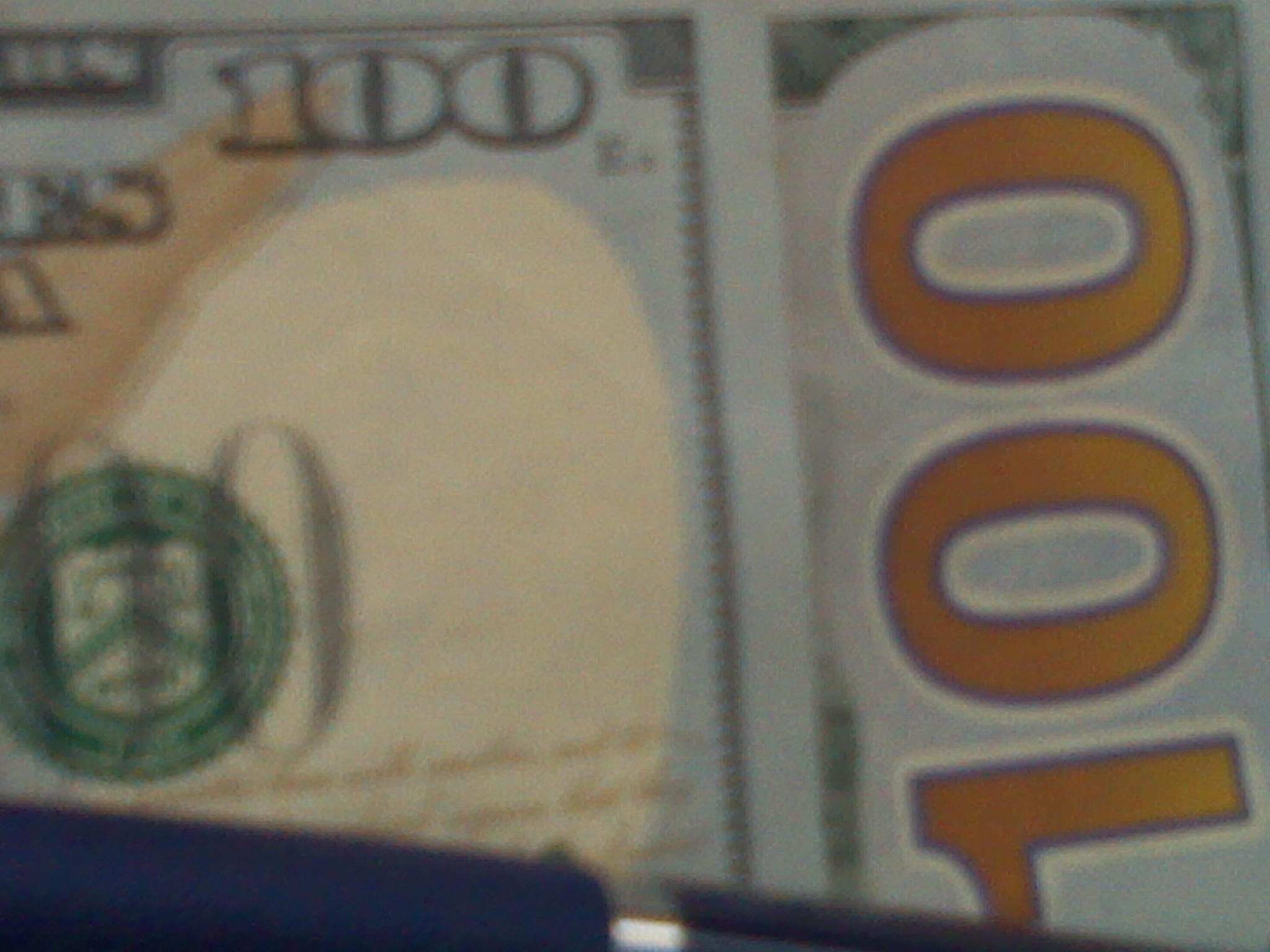 Image of 100 dollar bills: Pat Z Anthony