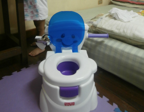 Cheer Me Potty that my kid is using for the potty training, this is Fisher Price.
