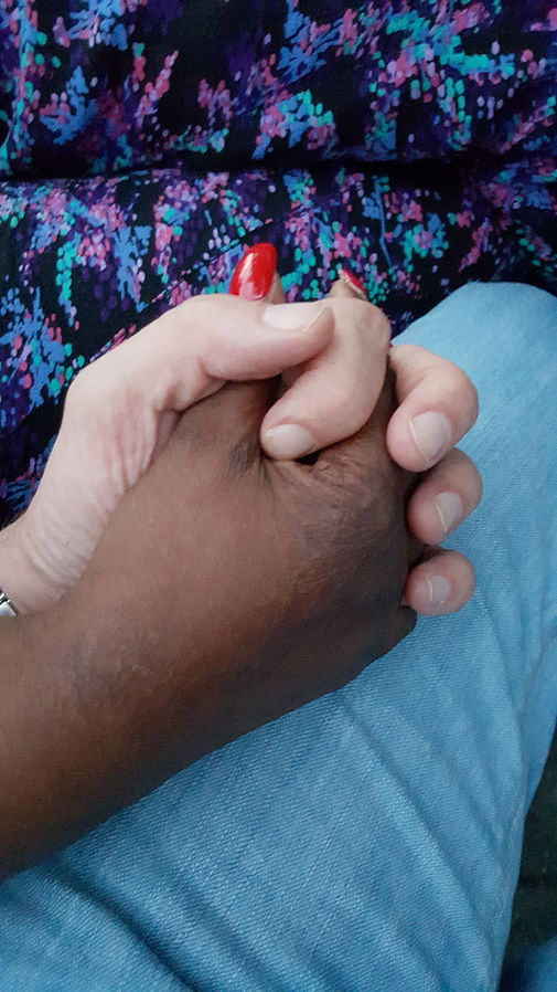 https://commons.wikimedia.org/wiki/File:Female_black_and_male_white_hand_(holding,_adult).jpg