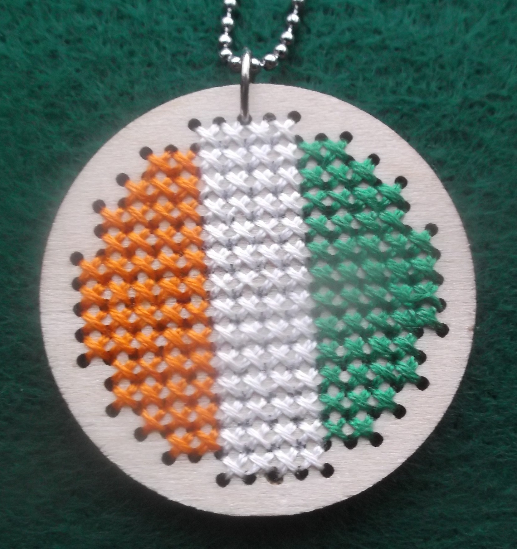 Photo taken by me of Pendant that I counted cross stitched