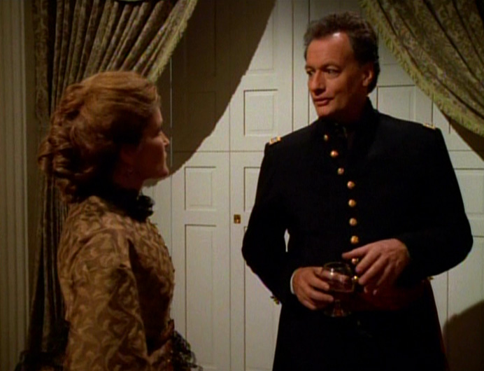 Capt. Kathryn Janeway (Kate Mulgrew) in Civil War garb with Q (John de Lancie)