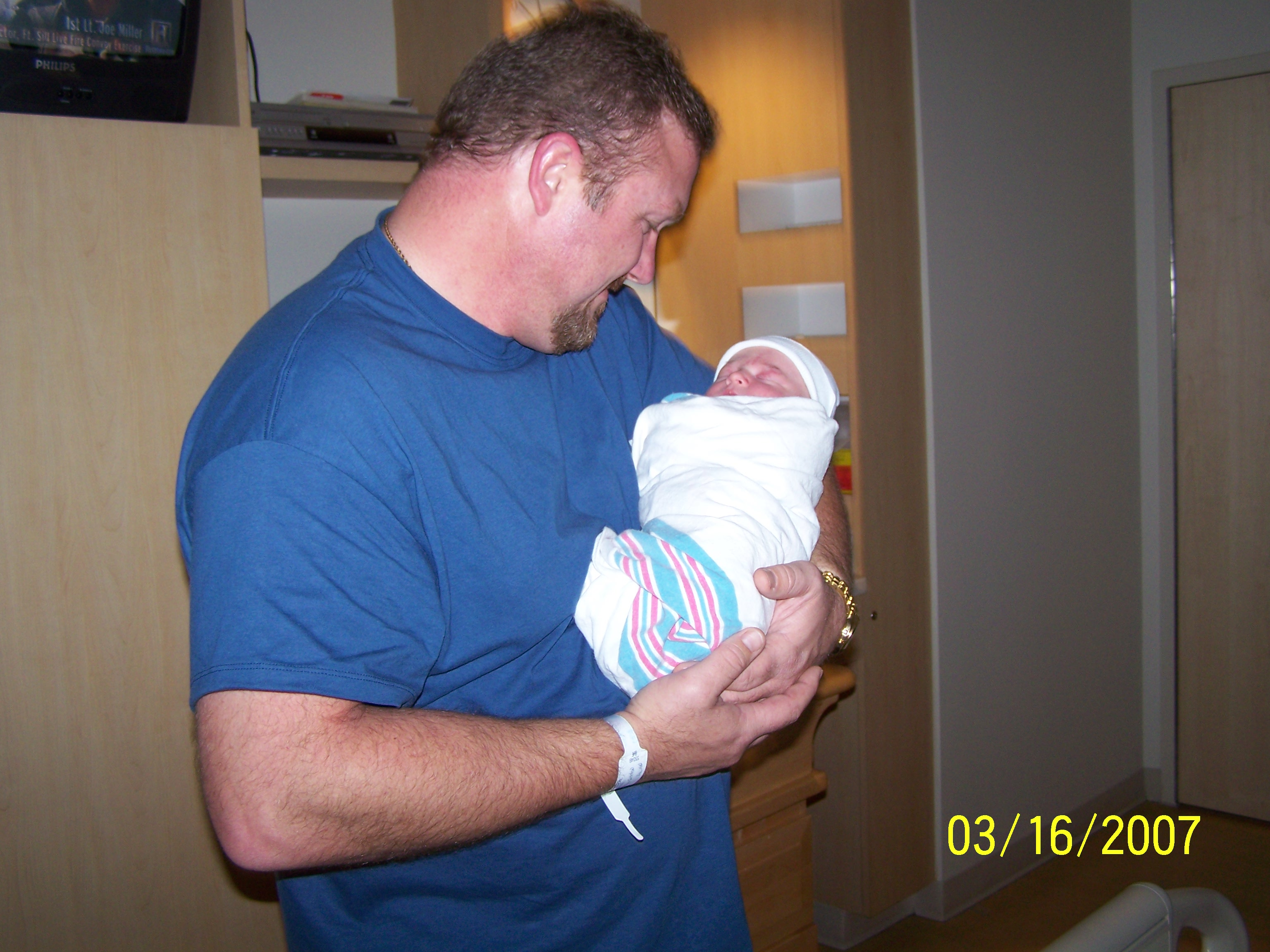 Tommy holding his newborn son... Photo owned by Gloria Faye Brown Bates
