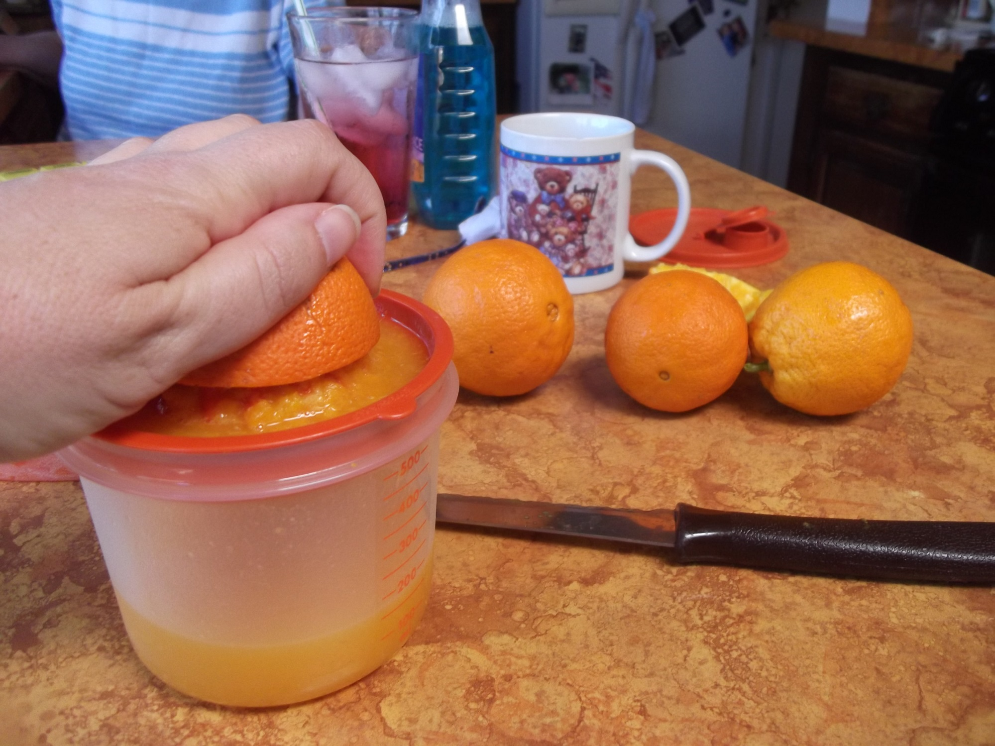 Photos I took of our orange tree out front and me juicing oranges