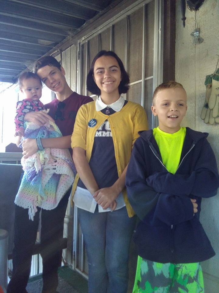 From left to right: Gavin holding Emma, Ari, and Justin