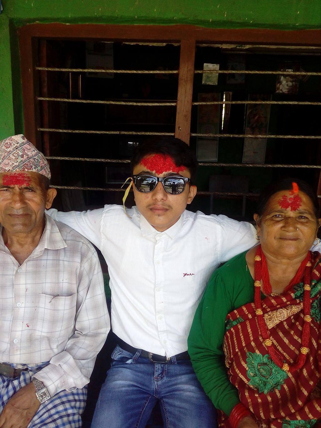 Tika in forehead with my  grandpa and grandma