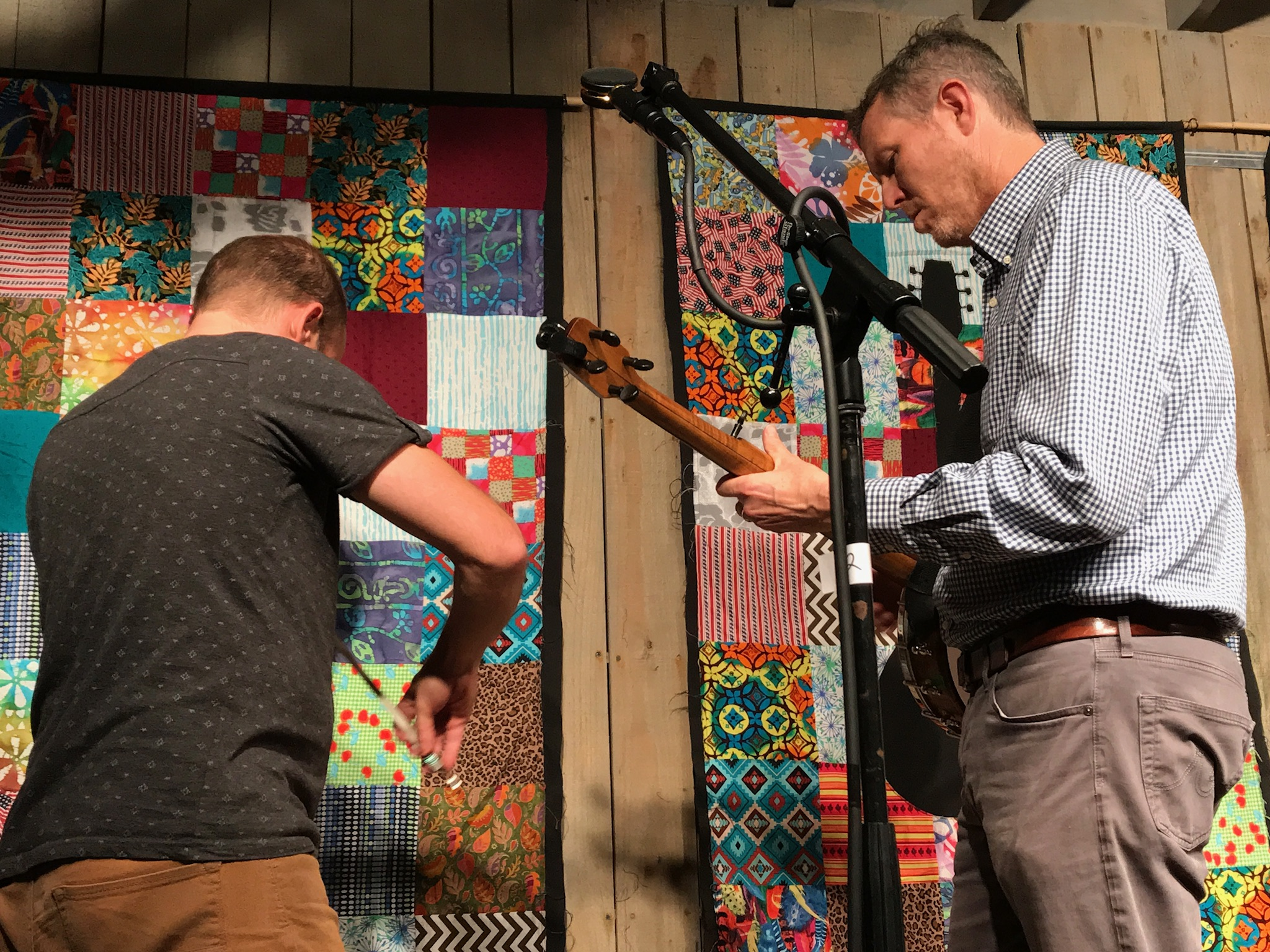 Shad Cobb and Robbie Fulks warming up for a fiddle and banjo duet at the start of the second set at the IBMM in Owensboro.  Photo taken by and the property of FourWalls.
