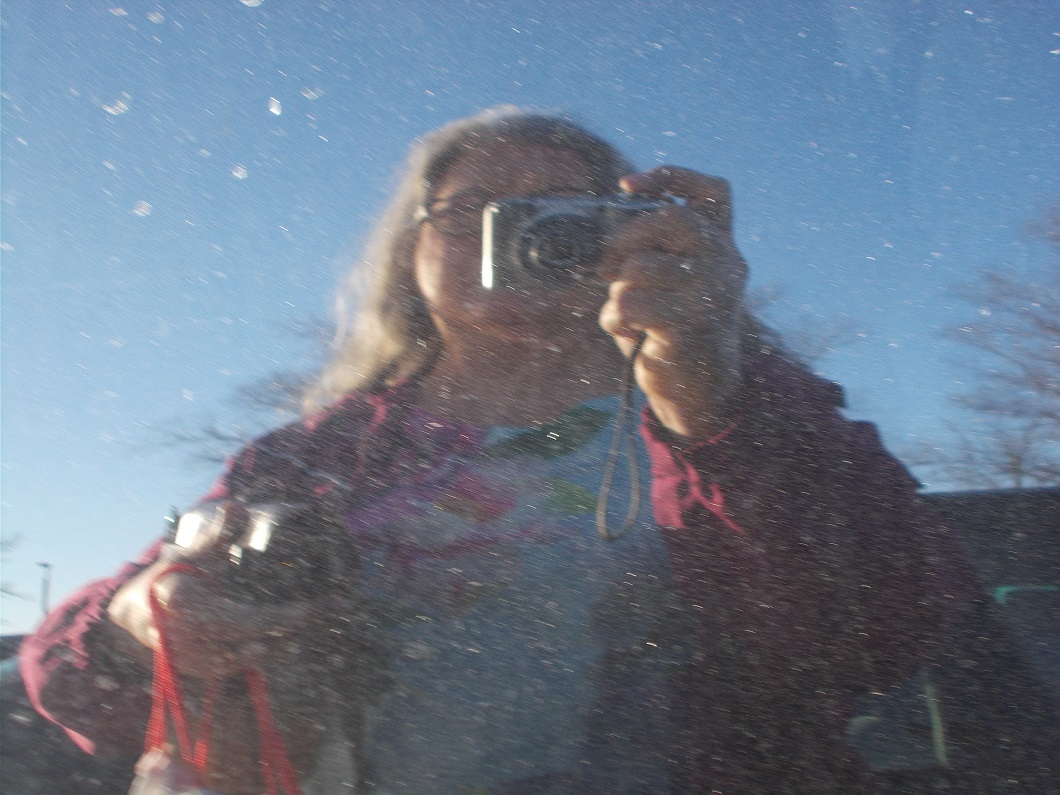 dirty car window reflection of me