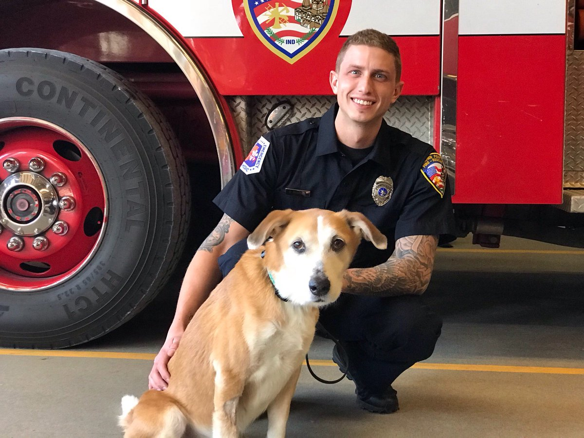 Firefighter in Indiana and Chiquita the dog