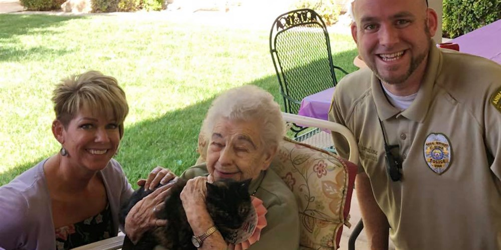Harley the cat meets Lillian who is celebrating her 103rd birthday.
