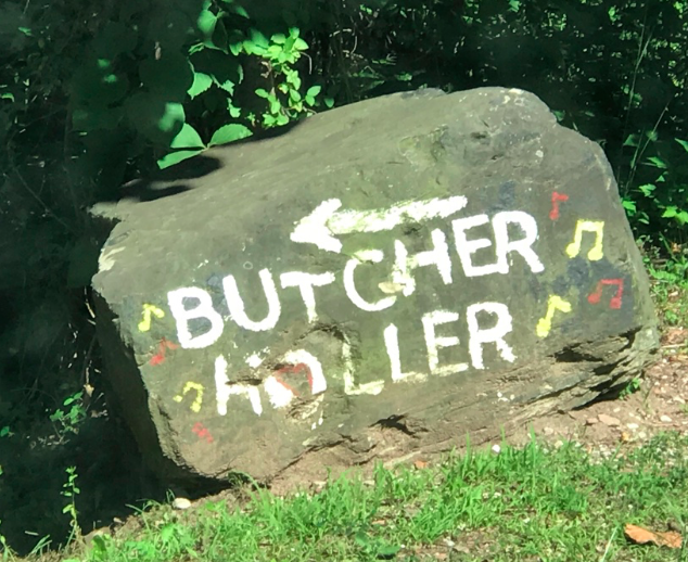 """Redneck Road Sign""? No, just a painted rock pointing the way to Loretta Lynn's birthplace outside of Van Lear, Kentucky.  Photo taken by and the property of FourWalls."