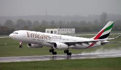 Emirates A320 - Emirates Airbus A320 touching down.