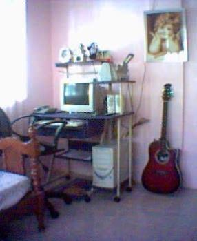My wallpaper - There's my wallpaper, It's a picture of my room with my cross stitch and my guitar and my PC.