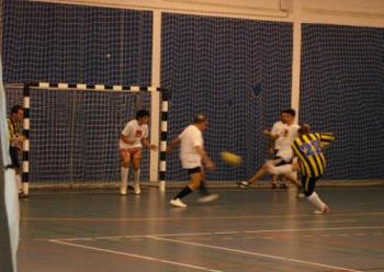 Playing futsal  - Me scoring a goal, and there´s a older man.