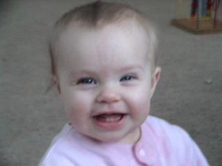 my smiling baby girl - This is my baby girl who is 9 1/2 months old and showing off her new teeth that came in on Christmas.