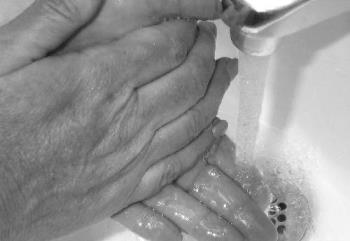 Washing hands - Hands being washed with soap and running water
