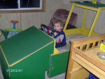 """Another view of my grandson's bed - My grandson playing in his """"Poppy"""" made tractor bed."""