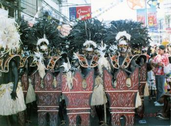 Philippine Festival, Dinagyang - A tribe of warriors in the dinagyang festival taking a break after a performance