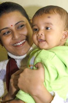 mother and child in happy mood - mother and child after pregnancy