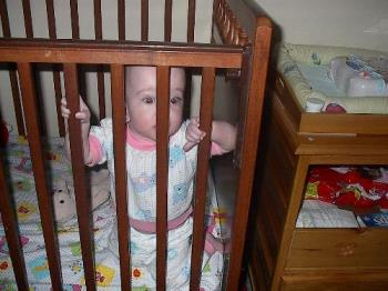 baby in crib - baby in her crib.