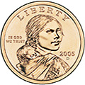 Sacagawea One Dollar Coin - The Golden Dollar's obverse, or heads, has Sacagawea portrayed in three-quarter profile. In a departure from numismatic tradition, she looks straight at the holder. On her back, Sacagawea carries Jean Baptiste, her infant son. Six months pregnant when she joined the Lewis and Clark expedition, Sacagawea gave birth to Jean Baptiste early in the journey.