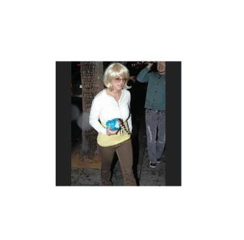 Blond Britney - After she shaved her hairs off she goes around town wearing a blond wig to cover her bald head.