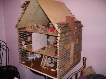 doll house - doll house made out of tree branches.
