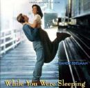While You were Sleeping - A romantic comedy on a woman who has a big crush on a train passenger whom she regularly sees in the train station where she's working. When an accident happened to the man, she eventually found herself in love with the guy's family, who would do everything to make her marry the guy (they actually thought she's his fiance); and turned out to fall in love, for real, with the guy's brother...during the time that the guy was in coma, or while he was sleeping.=