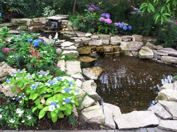 This is the flower pond of my dreams! - I'm hoping to have a flower pond in my yard this year.