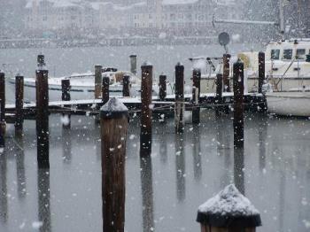 community docks getting snow - huge snowflakes on the water