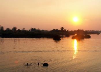 Sunset on the river - Photo taken last summer while cruising on a boat down the river