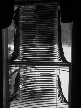 melted blinds - the heat of the sun between the window and the plastic melted our venetian blinds!