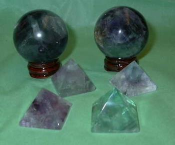 Fluorite Spheres & pyramids - Fluorite is the ultimate stone of Well Being. It provides purification, cleansing, and eliminates that which is in disorder. It works within the physical, emotional, and spiritual systems, bringing a sense of calmness and peace. It's multi-colors enhance all aspects of well being, notably the purples for wisdom and intuition, and the greens for healing and abundance.