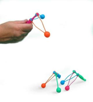 Clackers - Clacker Toys. My sister had a huge collection of these when she was young.
