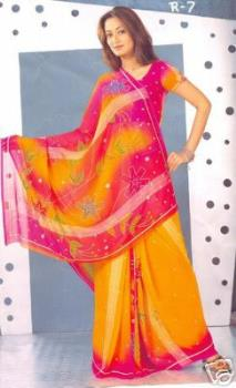 Saree clad model - Saree's made at Kanchi becomes more demand in western countries. On line saree sales also improved much.