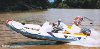 Boating - Man driving a speed boat